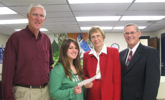 Brittney Brown with Principal Carl Clark (left) and Harriet Morgan and Larry Foreman of the Society